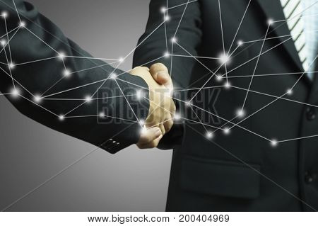 businessman shaking hands on gray background and connection concept