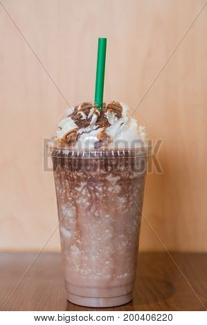 A cup of Chocolate smoothies with whipped cream on wood table interior coffee shop.