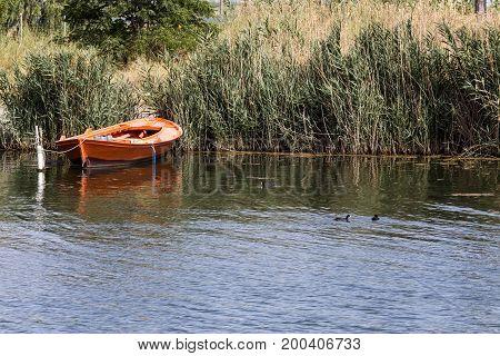 Old fishing boat moored at the lake shore