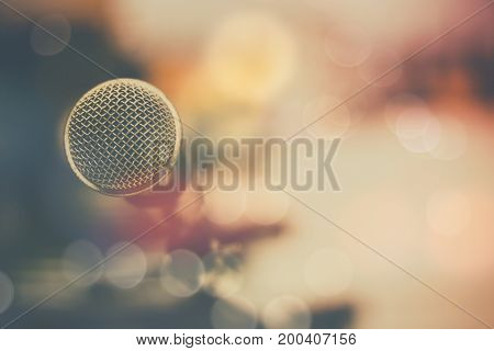 microphone and bokeh background concept as music instrument in studio room and meeting hall