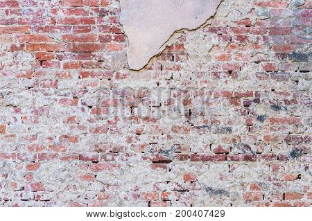 background texture old brick wall with remnants of plasters