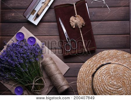 Set of travel accessory for woman with cup of tea on wooden vintage background