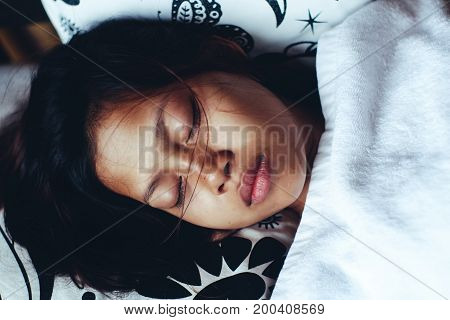 Young Asian woman sleeping peacefully in the balcony during summer vacation