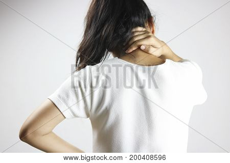 women has neck pain and back illness concept on grey background
