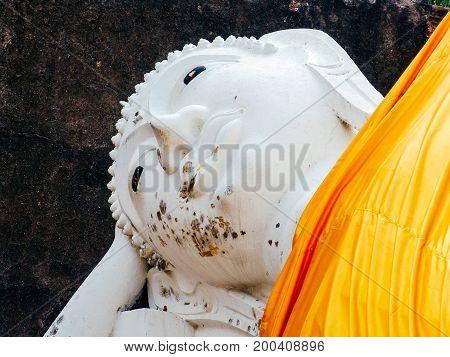Ancient Leying Buddha statue in Ayutthaya ruins complex near Bangkok Thailand