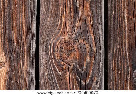 Texture beautiful fresh brown wooden boards with hollows. Horizontal photo wallpaper