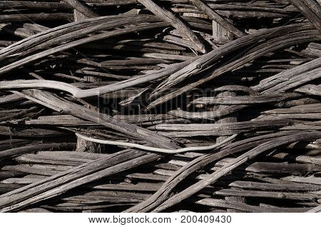 Texture old weave fence gray close-up weaving. Horizontal photo wallpaper