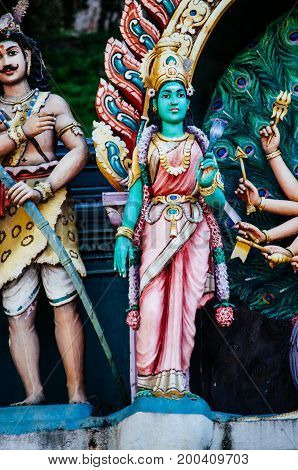 Statue Hindu deities on the roof of temple within Batu Caves. Batu Caves - a complex of limestone caves in Kuala Lumpur Malesia