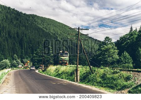 train in the mountains in sunny summer day