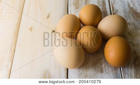 Close Up Of Fresh Chicken Egg On Nature Wooden Table