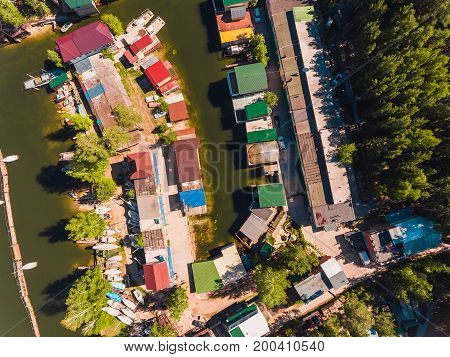Aerial view to the boat station in the lagoon Moored boats and yachts. Fresh green water