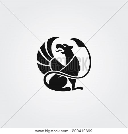 Logo silhouette of the griffin with open beak and raised wing, in the circle