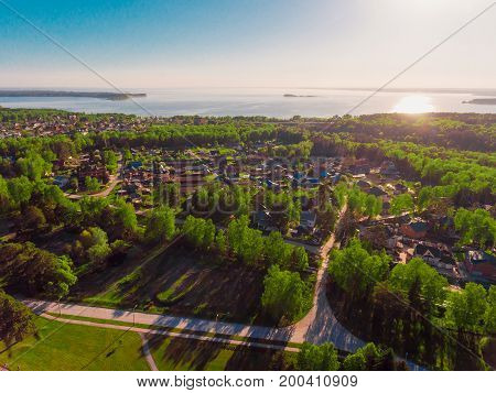 Panorama aerial view shot on a cottage village in a forest, suburb, village, above