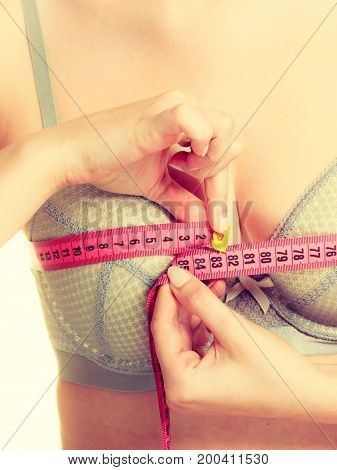 Woman In Bra Lingerie Measuring Her Chest Breasts.
