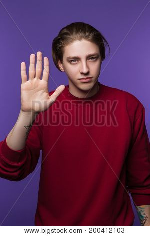 Male with stop hand gesture. Protest emotion. Young man swearing oath, freedom advertising