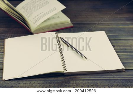 book and pen on table with copy space