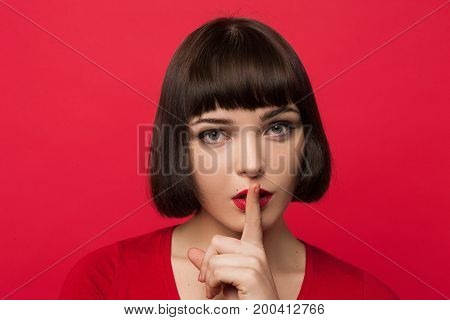 Young girl secrets. Silence background. Modern youth gossips, fashion female model