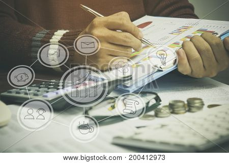 man writing on business paper with graph concept as finance capital money account and success