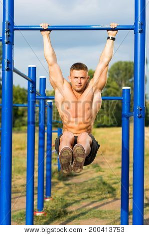 Man Doing Crunches During Street Workout