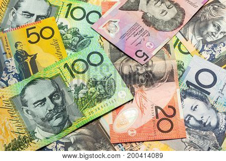 Colorful of Australian dollars money background. Stack of doll bills on table.