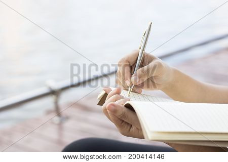 Writing dairy on notebook in coffee shop concept as memory of life and education