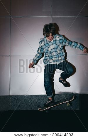 Extreme tricks with skateboard. Street subculture, fast speed, hobby for young male