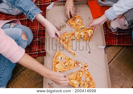 Pizza friends party top view. Communication together outside, unhealthy food