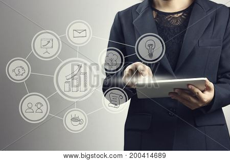 businesswomen press on smartphone and laptop with connection line logo