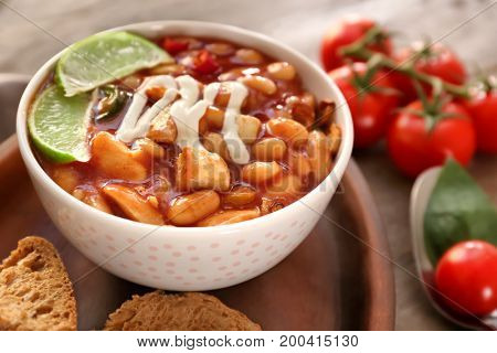 Delicious turkey chili in bowl on table