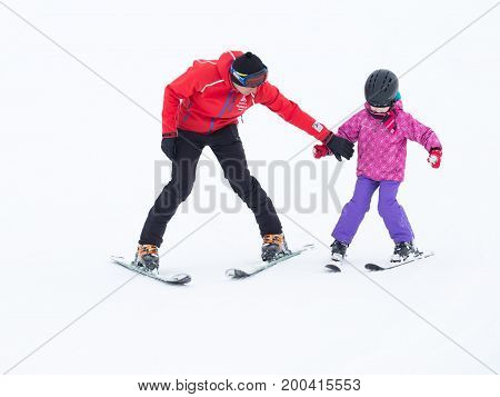 Sochi - March 28 2017: A child in ski clothing learn to ski with a coach in the mountains March 28 2017 Sochi Russia