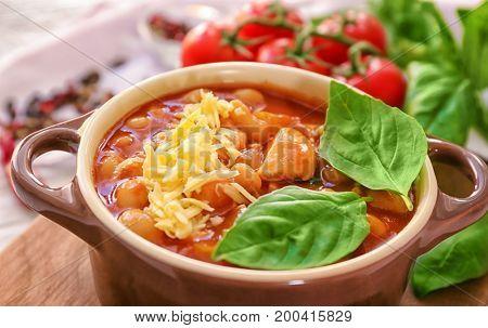 Delicious turkey chili in casserole on table