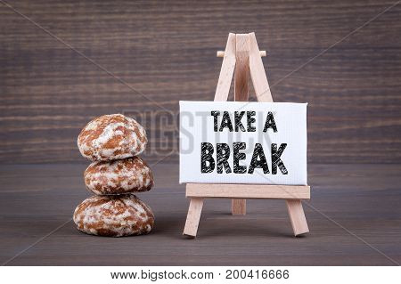 Take a break. Biscuits with sweet filling on a wooden background.