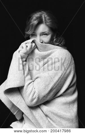 Beautiful elderly woman posing on black background