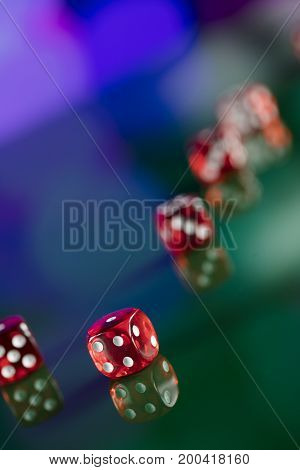Dice on colorful bokeh background. Casino concept.