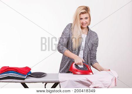 Happy Woman Doing Ironing