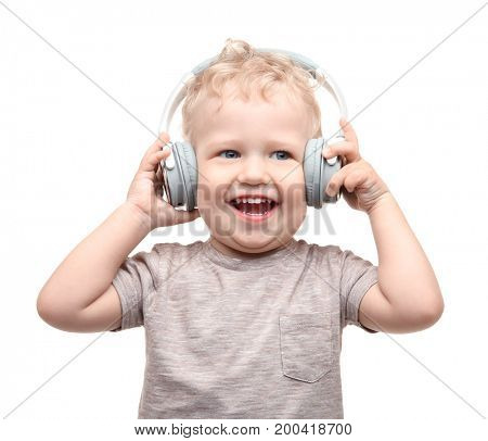 Cute little boy with headphones on white background