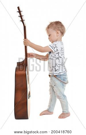 Cute little boy with acoustic guitar on white background
