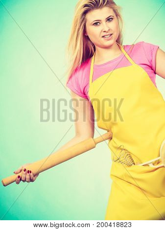 Woman Wearing Apron Holding Rolling Pin