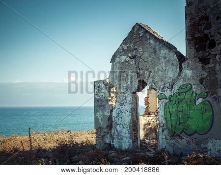 abandoned house ruins with broken walls and blue sky on the seaside