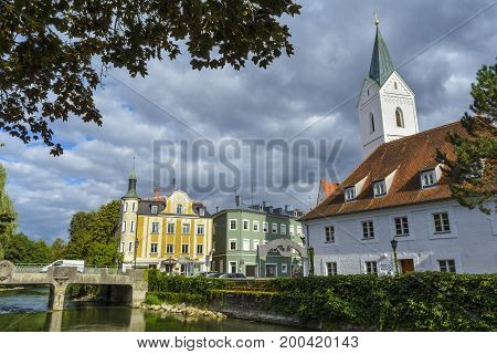 Evening view with a side of Amper river in Furstenfeldbruck on September 06, 2015 in Bavaria Germany Furstenfeldbruck is a town in Bavaria Germany. It is the capital of the district of Furstenfeldbruck.