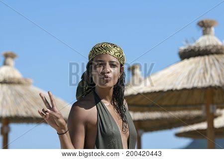 Young Arab Woman Showing Peace and Kiss Gesture