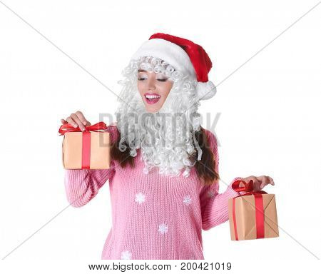Attractive lady in Christmas hat  and fake Santa Claus beard holding gift boxes on white background
