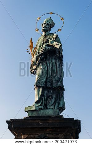 Statue of Sf. John of Nepomuk on the Charles bridge in Prague, Czech Republic.