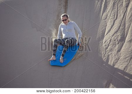 Thrill seeking woman Playing in the Sand Dunes Outdoor Lifestyle
