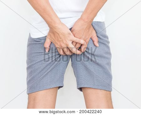 Young man has pain in the butt Hemorrhoids Anal disorders.