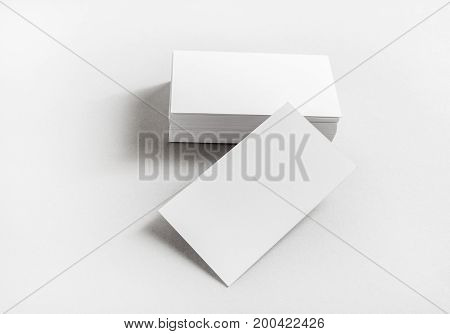 Photo of blank business cards on paper background. Template for branding identity. Mockup for ID. Studio shot.
