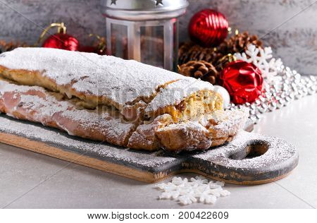 Stollen - German traditional Christmas cake covered with icing sugar