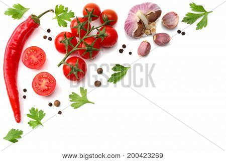 cherry tomato, red hot chili pepper, garlic and spices isolated on white background. top view