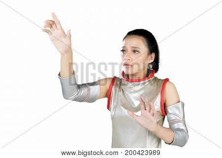 Asian woman wearing a futuristic costume while touches something on the transparent screen isolated on white background