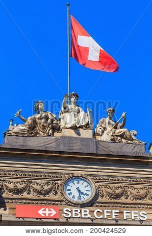 Zurich, Switzerland - 20 July, 2016: upper part of the building of the Zurich main railway station, above the main entrance to it. the building of the Zurich main railway station was designed by architect Jakob Friedrich Wanner and opened in 1871.
